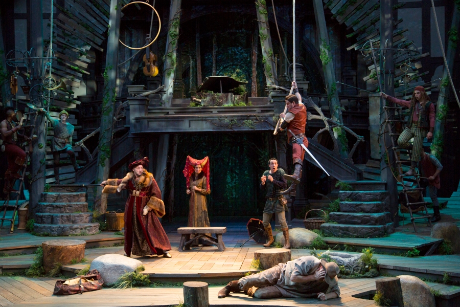 A life of crime looks pretty good in Sherwood Forest.  Robin Hood (John Tufts) and his band are up to robbery again. Ensemble. Photo: T. Charles Erickson.