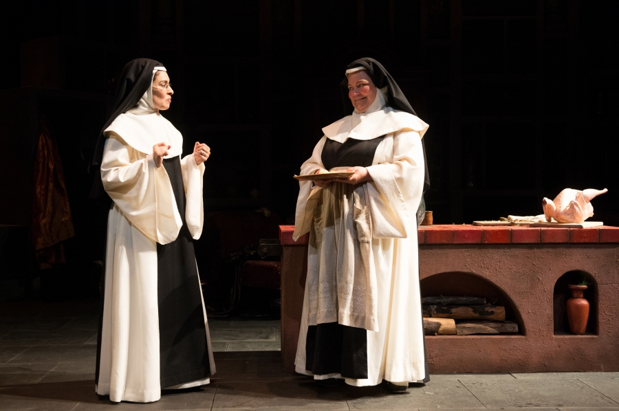 Sor Filomena (K.T. Vogt, right ) offers Sor Rufina (Vilma Silva) a sample of her prepartions for the visiting Inquisition. Photo by Jenny Graham.