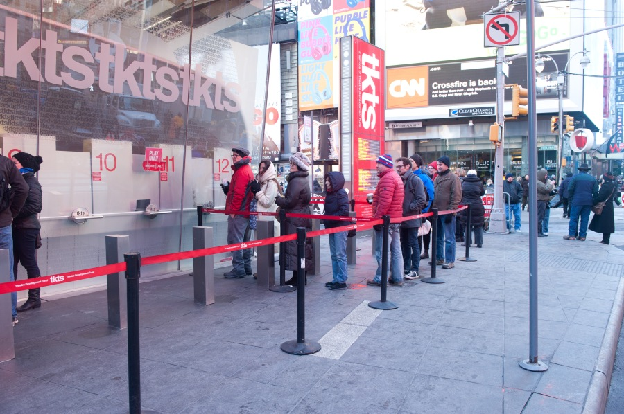 Meanwhile, on the other side of the booth, the line to buy tickets for plays had only nine people in it.