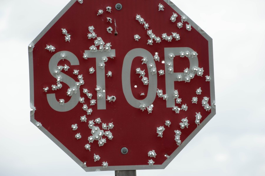 Guns don't kill stop signs.