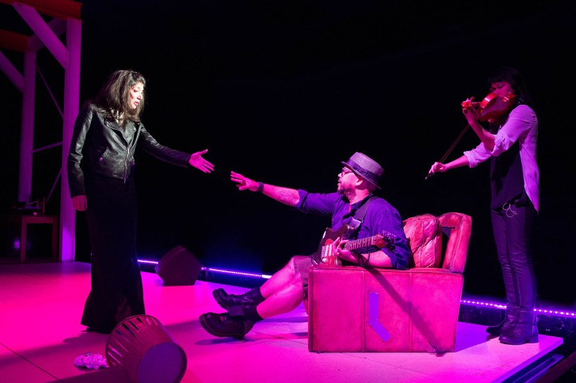 Cleo (Miriam A. Laube) and Heimvey (Luqman Brown) get reacquainted as Clara (Dana Lyn) plays. Photo by Jenny Graham.