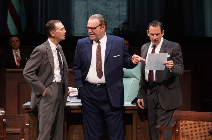 Robert McNamara (Mark Murphey), President Johnson (Jack Willis) and Vice President Hubert Humphrey (Peter Frechette) react to the rising cost of the war. (Ensemble, gallery, Richard Elmore) Photo by Jenny Graham.